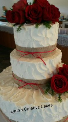 Rustic wedding cake with red roses