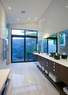 Imagine this overlooking the sea or mountainscape!  @CheviotProducts loves the floor-to-ceiling windows as a feature point. Also the under-sink storage is very cool!