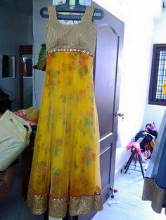 Yellow Net anarkali with brocade lining