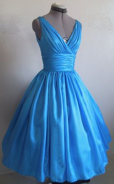 The perfect simple but elegant 50s style dress. made from blue taffeta. Any size welcome.