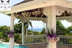 Hummingbird Hall Jamaica destination wedding purple floral gazebo decorations.