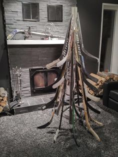 Couldn't find a good hockey stick Christmas Tree on here so I built my own. Hockey Decor, Hockey Room, Stick Christmas Tree, Unique Christmas Trees, Holiday Tree, Xmas, Hockey Stick Crafts, Hockey Sticks, Gifts Love