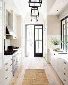 Swap the floors out for a darker chevron or herringbone wood design, maybe brass hardware, and this is pretty much my dream kitchen.