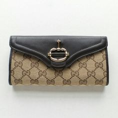 """New Gucci Womens Wallet Up for sale is a new Gucci women's wallet..it is a double sided wallet so the first pic is one side of the wallet which opens up to be a large pouch for coins and such, and the next 2 pics are the other side which holds cards and bills etc...comes exactly as seen in pics, I took all pics myself of the actual item I will send...can't find the box so just selling the wallet Dimensions: 7"""" X 3.5""""  I will ship ASAP with uses priority mail 2-day shipping Gucci Bags Wallets"""
