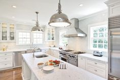 kitchens - Restoration Hardware Harmon Pendant blue subway tiles backsplash stainless steel apron sink white glass-front kitchen cabinets glass shelves stainless steel apron sink sink in kitchen island