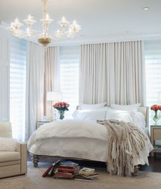 omg, this is exactly how I want my room to look. Curtains don't always have to block a window. Drape them on the wall with a rod and use as a backdrop to your bed.