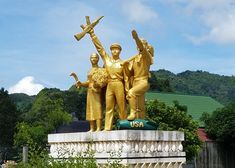 Laos. Golden Statue for Laos' Secret War. After Communism emerged victorious in 1975, a memorial was erected in the city of Vieng Xai, a Pathet Lao stronghold during the war. The patriotic group statue blends various sculptural traditions and iconographies to riveting effect.