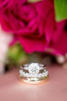 Mikkel Paige Photography photos from a wedding at Prospect Park Boathouse in Brooklyn, NY. Image of the bride and groom's diamond and gold wedding rings. #diamondring #solitaireengagementring #eternitydiamondring
