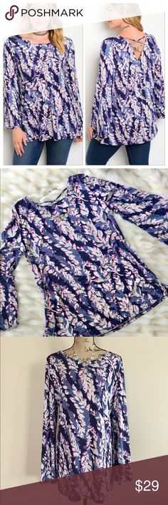 "Plus floral print jersey top 🇺🇸 Navy, periwinkle, pink, and ivory floral print jersey top has full length bell sleeves, modest scoop neck, straight hem, and a cross cross accent back. 95% polyester 5% spandex. Machine wash. Approx measurements, 1XL (B-22 1/2"", L-30"") 2XL (B-23 1/2"", L-30"") 3XL (B-25"", L-31""). Made in USA. Tops"