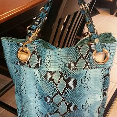 Steven by Steve Madden Tote NWT Awesome aqua snake print tote. New,  never used...bought it at Nordstrom. Excellent condition. Magnetic closure. Pretty striped lining with zipped pocket and elasticized slip pockets inside. Small slip pocket outside.  Goldtone hardware. Size is approx. 13 (w) x 14 (h) x 6 (d).  This is a large, beautiful bag. Steven by Steve Madden Bags Totes