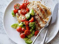 Grilled Chicken with Tomato-Cucumber Salad : Ditch starchy sides in favor of this energizing salad of cucumbers and tomatoes. The simple dill-and-lemon dressing complements the grilled chicken without heaping on extra fat or sugar. via Food Network Fast Healthy Meals, Easy Meals, Healthy Eating, Healthy Recipes, Food Network Recipes, Cooking Recipes, Cooking Food, Cucumber Salad, Tomato Salad