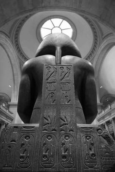 "The back of a seated Ramesside king, wearing the Nemes headdress. The cartouche reads ""OuserMaatRe SetepenRe"". Cairo Egyptian museum."