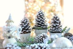 Pine Cone Christmas Trees are fun and easy to make. They create a pretty holiday vignette in your home or on your dining table.