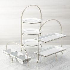 Made of sturdy iron with a nickel-plated finish, this three-tier stand provides a space-saving solution to stacking dinner plates or displaying buffet items. Plates not included. Cool Kitchen Gadgets, Kitchen Items, Cool Kitchens, Kitchen Decor, 3 Tier Stand, Tiered Stand, Kitchen Collection, Crate And Barrel, Kitchen Accessories