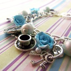 Alice in Wonderland turquoise and silver charm bracelet, drink me bottle by FayeValentineJewelry