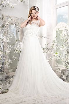 Sweet and feminine, this Ellis Bridals gown is versatile enough for almost any wedding theme and venue