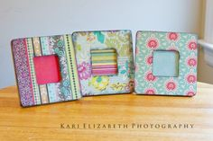 One-dollar frames at Michaels covered in scrapbook paper with distressed edges.  Easy!