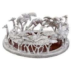 """Patrick Mavros Silver Giraffe Wine Coaster Giraffe wine coaster in sterling silver with a wooden base. Height: Designed and manufactured in Zimbabwe. Marked """"PM"""" for Patrick Mavros. Wine Coaster, Silver Candelabra, Just Give Up, Anklets, Tea Set, Coasters, Zimbabwe, Silver Jewelry, Pure Products"""