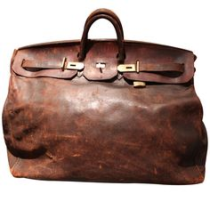 Giant, Beautifull Worn, Hermes Travel Bag | From a unique collection of antique and modern trunks and luggage at http://www.1stdibs.com/furniture/more-furniture-collectibles/trunks-luggage/