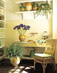Potting room w/ utility sink in an old French painted table, tile from Renaissance Tile & Bath - designer: John Oetgen - photographer: Ngoc Mihn Ngo - House Beautiful