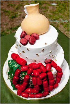 Coral beads, kola nut, and palm wine gourd designed cake Nigerian wedding bride