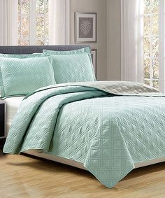 Update your décor and sink into luxurious softness with this lush bedding set, featuring coordinated colors and an ultrasoft finish. A reversible design offers two bedroom updates in one piece.Includes quilt and two shams100% polyesterMachine wash; tumble dryImported