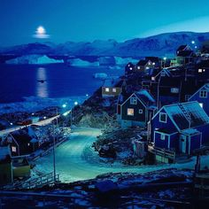 """""""Photo by @ciriljazbec / Full moon shines brightly over a frozen fjord in Uummannaq, a small town in the Northern Greenland, as families are preparing a…"""""""