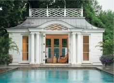 Folding doors open to pool house.