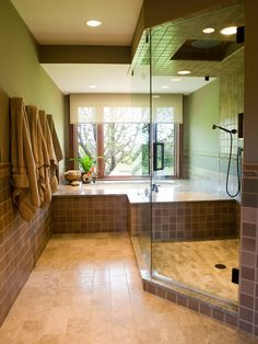 This room feels fresh! I particularly love the ginormous walk-in shower & the luxury tub next to the window.