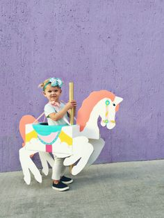 With a little paint and cardboard, a whimsical carousel horse costume can make…