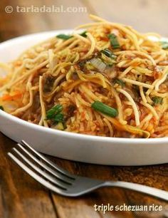Triple schezuan rice, combines hakka noodles, fried rice, crisp noodles and a spicy vegetable gravy in a single-layered dish! one definitely doesn't need to have anything else along with this.