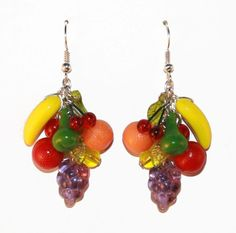 Fruit Earrings. These fabulous fruit bunch earrings look like they belong in a tiny glass bowl. They feature a Czech glass banana, lucite pear, glass cherries, lucite orange, glass grapes and lucite leaves. #fruit earrings #kitsch #rockabilly #vintage #style #retro #vintage #earrings #summer #novelty #50s #Carmen #Miranda Available from Lavish Accessories on Ebay