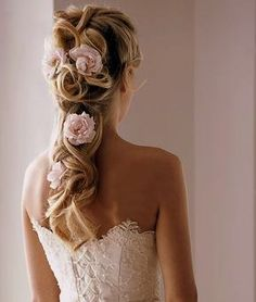 I'm liking something like this minus one flower and maybe more to one side so it falls over the shoulder.