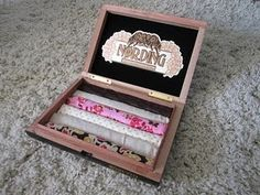 Cigar Box made into a jewelry box that stores your rings.  Perfect!!  My husband smokes a lot of cigars and has tons of boxes left over.  What a fun project to do for my girls.  If you are feeling really crafty you could decorate the box too!