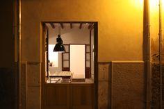 View through half opening doors at boulevard-level into Casita Sal de Mar, Port de Soller. www.sollersecrets.com