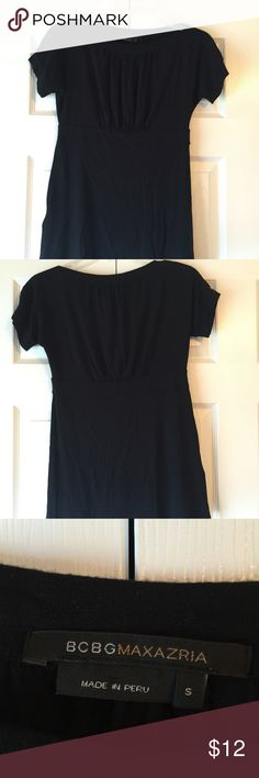 BCBGMaxAzria top Cute black shirt sleeve top in excellent condition and only worn twice. The top has gathering around the bust area. Comes from a smoke free and dog friendly home. BCBGMaxAzria Tops Tees - Short Sleeve