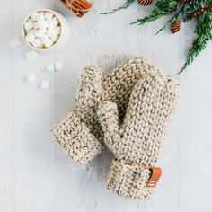 3 Hour Chunky Crochet Mittens – Free Pattern + Detailed Tutorial This classic chunky mittens pattern looks knit, but it's actually crochet! Get the full free pattern for women and detailed tutorial featuring Lion Brand Wool-Ease Thick & Quick. Beau Crochet, Crochet Mitts, Crochet Mittens Free Pattern, Bonnet Crochet, Crochet Gloves, Crochet Beanie, Free Crochet, Knitting Patterns, Knit Mittens