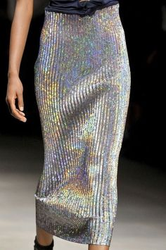 If you don't fancy glitter or sequins - Try this holographic midi skirt paired with a simple black knotted tee and boots. Fashion Week, Runway Fashion, High Fashion, Womens Fashion, Fashion Trends, London Fashion, Iridescent Color, Street Looks, Oldschool