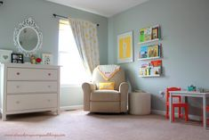 The picture ledges used as a bookshelves help make this #nursery corner so cozy!