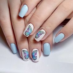 Blue nail art with butterflies