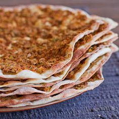 Lahmacun or Turkish Meat Pies - yummy!!  Should be eaten by squeezing fresh lemon juice over top and rolled up with fresh parsley and shredded lettuce.