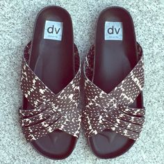 DV snakeskin print slip on sandals New in box these sandals feature black and white snakeskin print with studs on the side. Super comfy! In my opinion these fit between a 7.5 and an 8. Sorry  No trades but all reasonable offers are welcome :) Dolce Vita Shoes Sandals