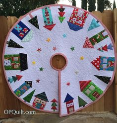 Christmas Tree Skirt 2014 Quilt #141 on the 200 Quilts List (Well, it feels like I made a quilt!) Here I laid out the old Christmas Tree Skirt on top of the new one; it was made in the early 1970s...