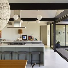 Kitchen with island/bar in this renovated mid-century modern home in Southern California. Credit: Crosby Doe Associates, Inc.