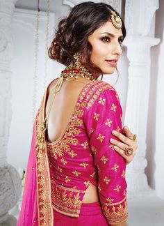 Magenta Embroidered Silk Lehenga features a beautiful silk lehenga. This piece comes with a cancan and bucram inner. Embroidery work is completed with zari, thread, and stone. Choli Blouse Design, Saree Blouse Neck Designs, Fancy Blouse Designs, Lehenga Designs, Blouse Patterns, Lehenga Blouse, Silk Lehenga, Party Wear Lehenga, Lehenga Wedding