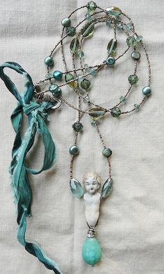 ❥ nina bagley~ beautiful colors...love the small silver beads with the larger stones...baby is a little creepy...