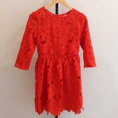 TPS Orange Floral Layered Lace Dressy This bright layered dress is great for warm weather occasions, with a light breezy slip beneath breathable lace. Designed and made in the USA. Dry clean only. TPS Dresses