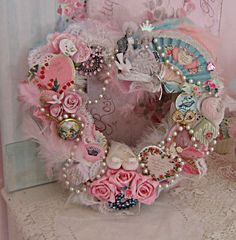 What a fabulously creative, eclectic, beautifully detailed shabby chic, pink and blue hued heart wreath. Amazing!