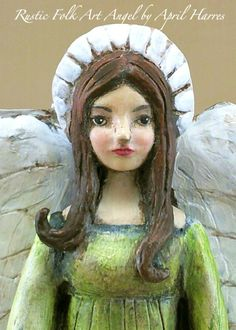 I sculpted this entirely from paper clay. Painted with Genesis oil paints. April Harres