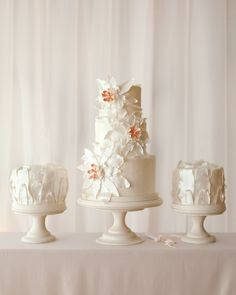 Love this gorgeous Sweet trio: Three tiers of lemon-raspberry and pistachio, plus smaller cakes of chocolate and orange and fruitcake